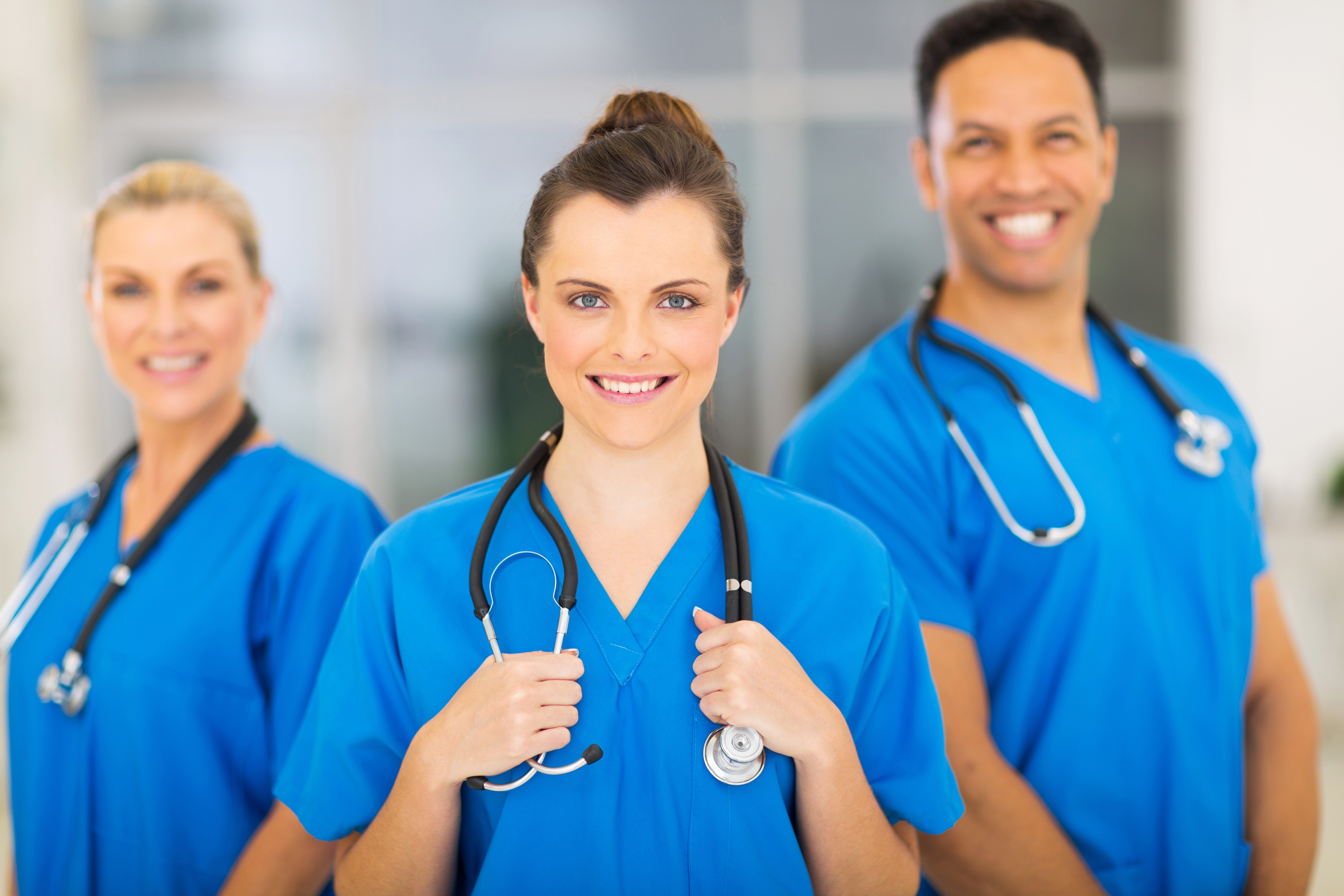 attractive medical nurse and colleagues in hospital