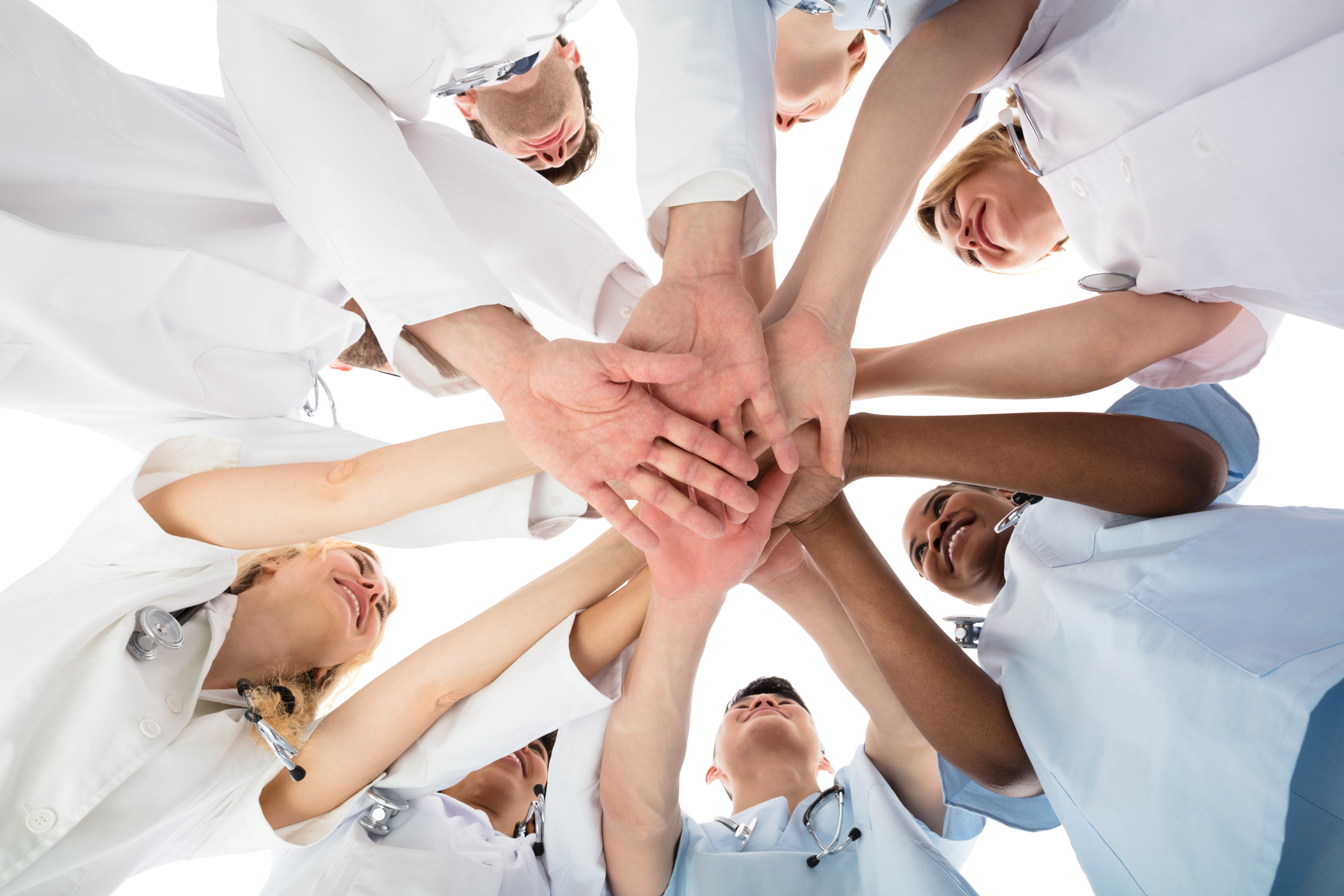 Low Angle View Of Smiling Medical Team Stacking Hands